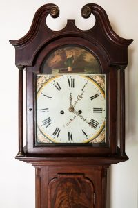 A closeup on a Grandfather clock. Is moving a Grandfather clock for you?