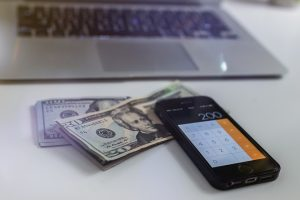 money, laptop and cellphone