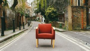 A red chair in the street.