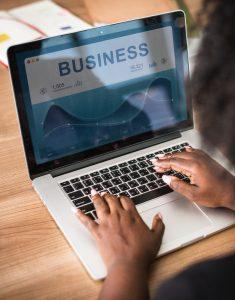 A woman googling business companies.