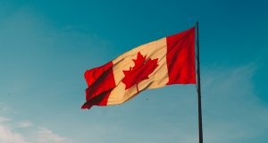 A Canadian flag in the air