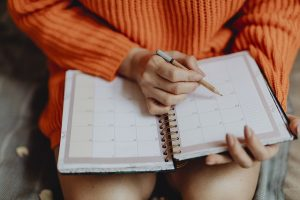 Girl with a planner in her hands