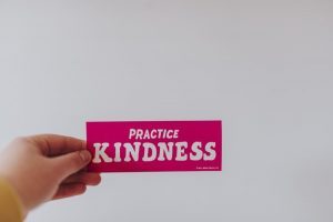 """Donating when moving - Note that says """"Practice kindness""""."""