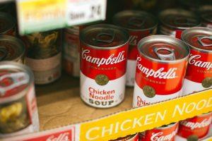 Soup cans on a shelf.