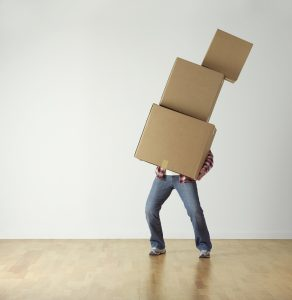 man carries boxes during the move