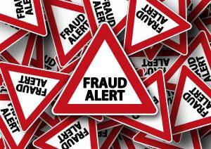 "Road sign that says ""Fraud alert"""