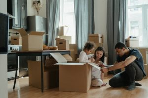 Family pay a deposit for the move
