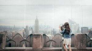 Woman standing on the top of the building in New york