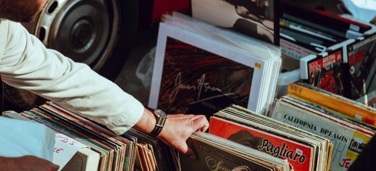 Man going through records.