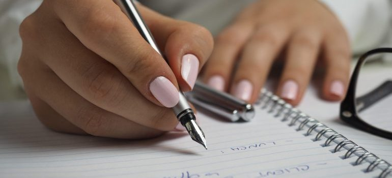 Woman writing on a paper