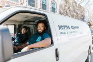 Two movers sitting in a van