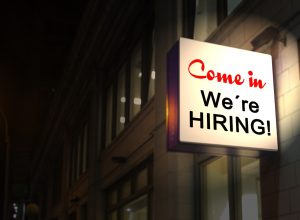 job hiring sign as one of the reasons why millennials are moving to Chicago