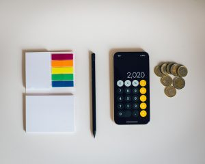 A calculator with some money and notes