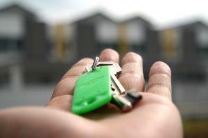 a hand holding a key