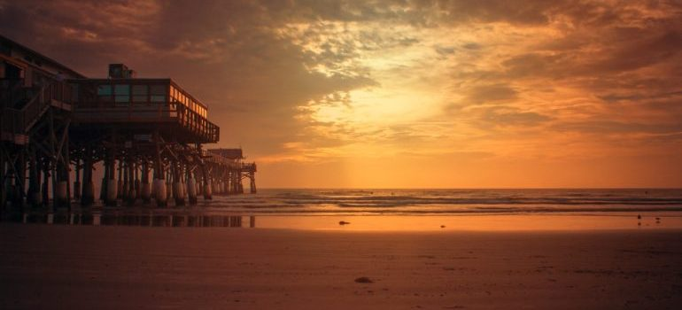 A view onto a lwhite sandy beach at sunset
