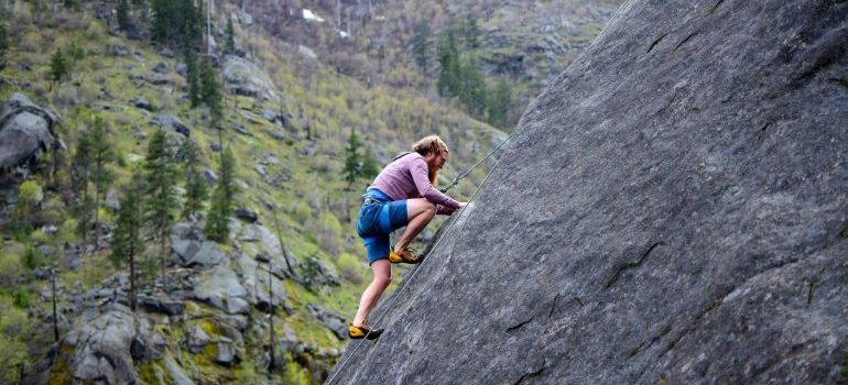 A man rock climbing after Moving from Chicago to Denver