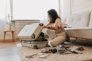 Woman packing by following ways to minimize costs