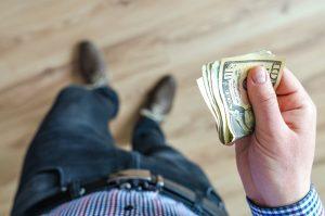 a man holding paper money