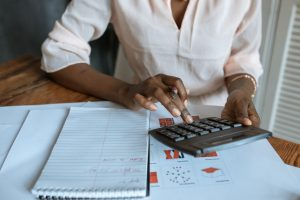 a woman calculating costs